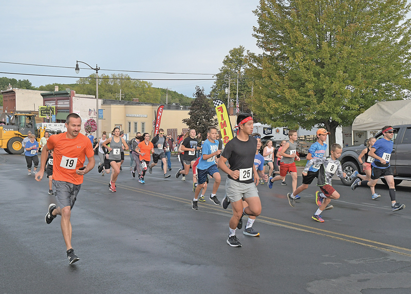 AND THEY'RE OFF — More than two dozen runners and walkers left the starting line Sunday morning, September 12 to take part in the Rustic Lore Days' 5K Run/Walk. This is the first time in several years that the local celebration has featured a running event. —photo by Shawn DeWitt