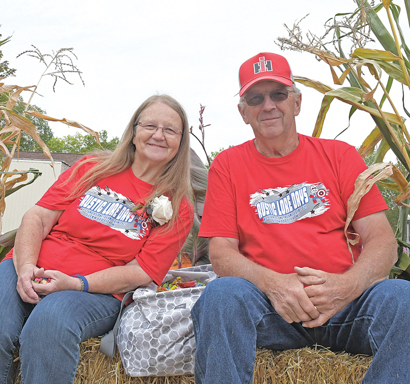 THE 2021 Rustic Lore Days Grand Marshals were Doris and Dennis Berends. The couple rode through Sunday's parade on a wagon decorated with corn stalks, hay bales and some of Doris' favorite flowers being pulled by a tractor. —photo by Shawn DeWitt