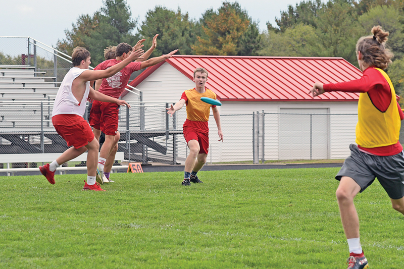 THE ACTION was fast-paced and furious during Ultimate Frisbee which was played on the football field last Friday as part of the activities for homecoming week at Colfax High School. —photo by Shawn DeWitt