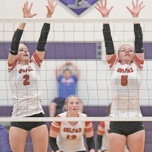 BLOCK ATTEMPT — Colfax's McKenna Shipman (left) and Maci Harvey attempt to block a hit by a Boyceville player during a Dunn-St. Croix volleyball match in Boyceville September 28. The Vikings won in three sets. —photo by Shawn DeWitt