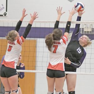 NET PLAY — Boyceville senior Libby Bygd (#19) looked to hit the volleyball past the block attempt of Colfax's Madison Barstad during a September 28 match in Boyceville. —photo by Shawn DeWitt
