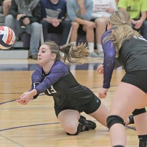DIVING SAVE — Junior Jacey Guy made a diving save on the volleyball in an October 7 home match against Elmwood/Plum City. —photo by Shawn DeWitt