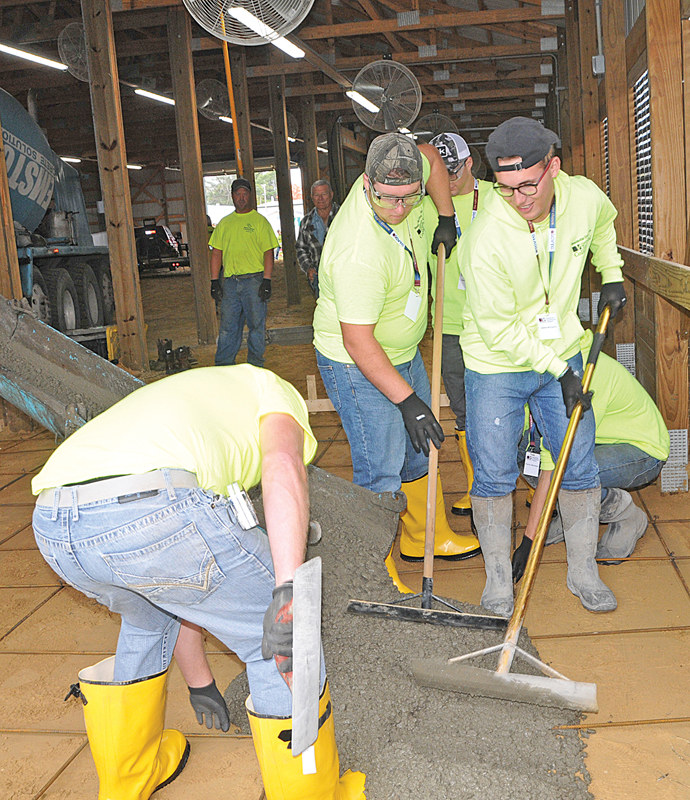 """HIGH SCHOOL STUDENTS learn the art of concrete work as part of the """"Build My Future Wisconsin"""" learning event held at the St. Croix County Fairgrounds on Wednesday, October 6th. - photo by Carlton DeWitt"""
