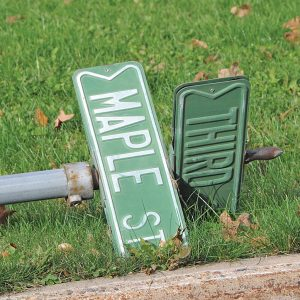 STREET SIGNS left laying in resident's yards following the street construction of Highway 170 in Glenwood City. —photo by Carlton DeWitt