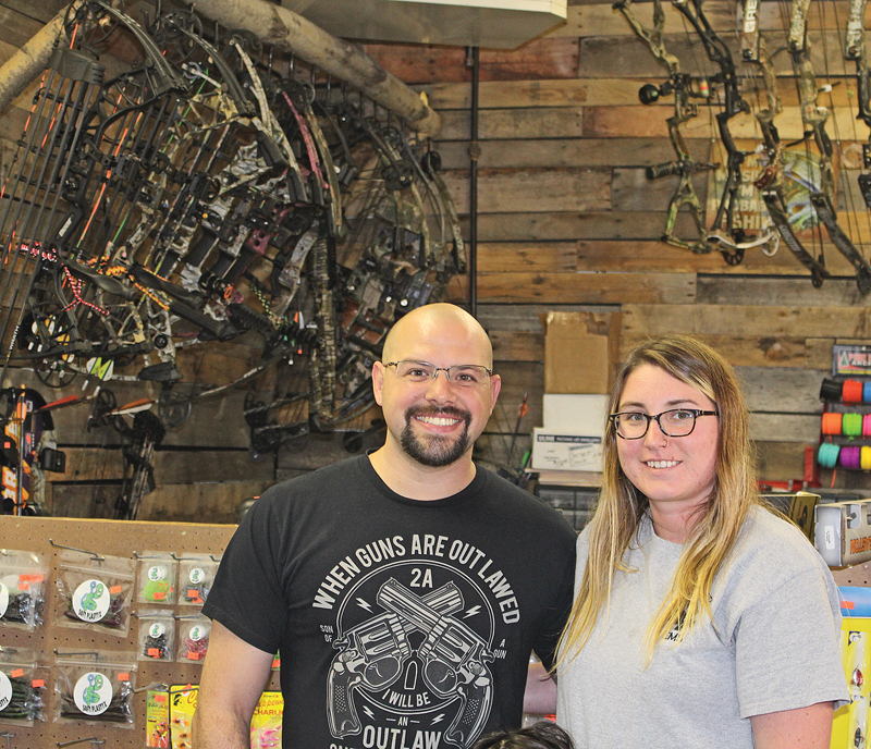 BAIT & BOW — Owners of the Glenwood Bait & Bow shop in Glenwood City Sean and Miranda Lybert are pictured in their shop just south of Glenwood City on Hwy 128/Syme Avenue. —photo by Missy Klatt