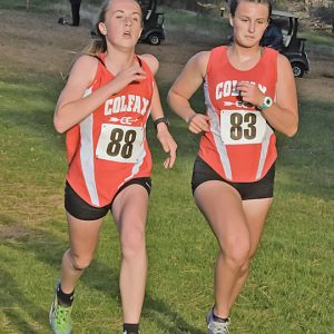 A DASH TO THE FINISH — Colfax's Kaysen Goodell (#88 on the left) and Jasmine Best (#83) ran side-by-side toward the finish line at last Thursday's Dunn-St. Croix Conference cross county meet in Mondovi. Goodell finished 11th while Best placed 12th as both ladies earned second-team all-conference honors. —photo by Jacob Maes Photography