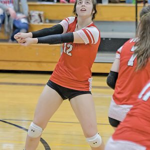 SENIOR Katelyn Sarauer (#12) of Colfax looked to hit the ball over the net during a D-SC volleyball match in Glenwood City last Thursday, October 14. The Vikings won in three sets to finish with a perfect 7-0 record and the program's eight conference championship in nine seasons. —photo by Jacob Maes Photography