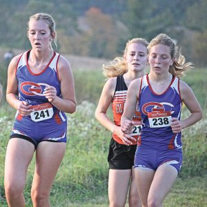 THE HILLTOPPERS' Libby Wagner (left) and Savanna Millermon (right) are shown running the course at the Spring Valley Cross Country Invitational held September 30. Millermon finished 53rd while Wagner took 56th. —photo by Missy Klatt