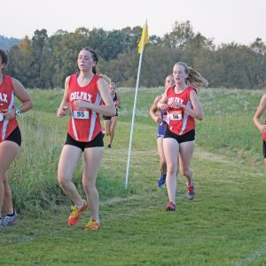 GROUP RUN — Colfax girls' runners, from left to right, Jasmine Best, Aynsley Olson, Jaycey Bowe, and Molly Heidorn are shown running as a group in the Spring Valley Cross Country Invitational which was held last Thursday, September 30. —photo by Missy Klatt