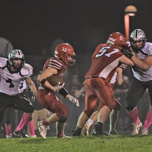 MOVING THE LINE — Mark Solberg of Colfax (#51) blocked for running back Asher Pecha (#33) allowing him to gain positive yards in the game against Elmwood/Plum City October 8 in Colfax. —photo by Kim Webb