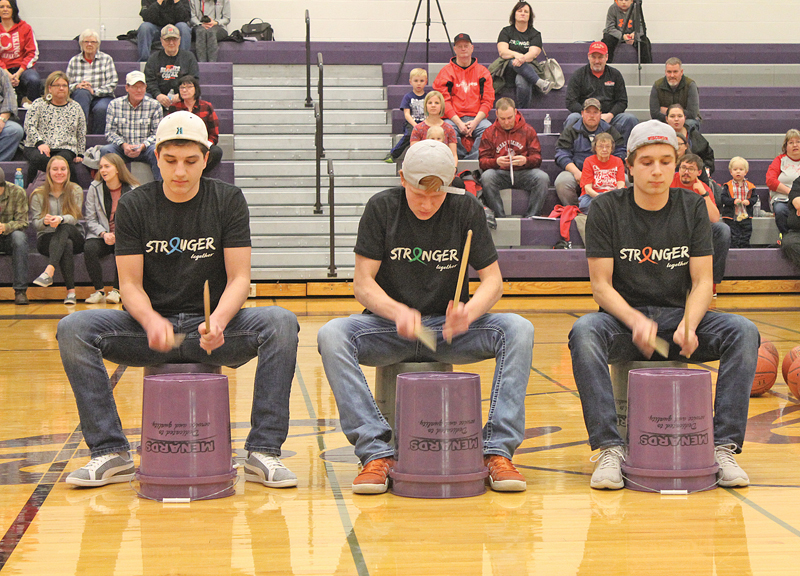 THREE BUCKETEERS— Connor Sempf, Jaden Reisimer and Brendan Sempf took to the court for a little pregame entertainment as they played the drums during the Coaches vs. Cancer event last Thursday evening, February 14. —photo by Amber Hayden